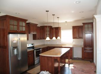 this beautiful kitchen in maple wood stained in brown mahogany  the custom island is 6 foot long and includes 6 pull out drawers and a full size trashcan  kitchen cabinets  rh   woodstockclocks com